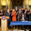 Democrats applaud Hickenlooper for signing SB213, the bill attached to the impending $1 billion tax hike campaign
