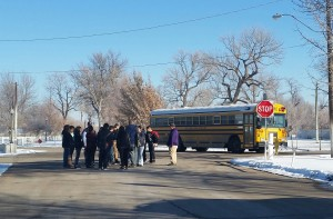 Weld County students arrive at the oil and gas task force protest, courtesy of the Fred Flintstone pedal-powered school bus.