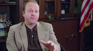 A screenshot from a lobbying video, taped in Jared Polis's congressional office.