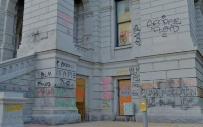 Graffiti capitol or festive tent city? Polis holds contest to redecorate driver's license