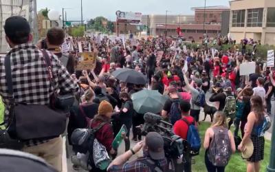 Protestors protesting arrest of protestors broke Polis's pandemic rules